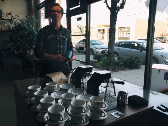 Barista extraordinaire Sam Schroeder of Olympia Coffee rocking the Mavam espresso machine.